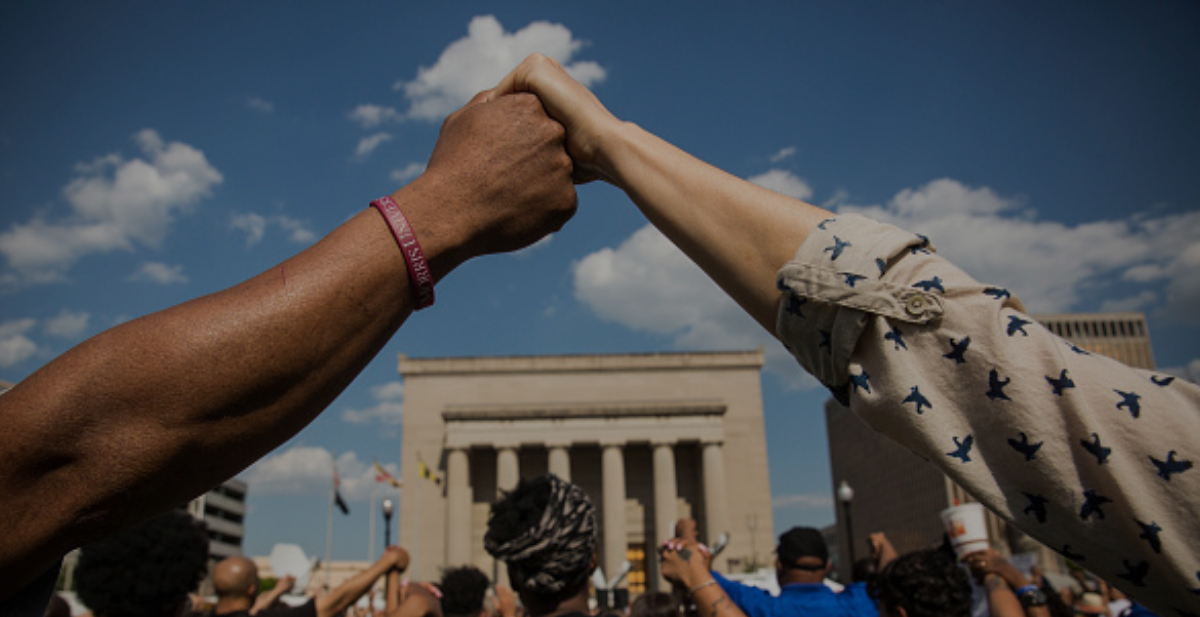 People holding hands in Protest