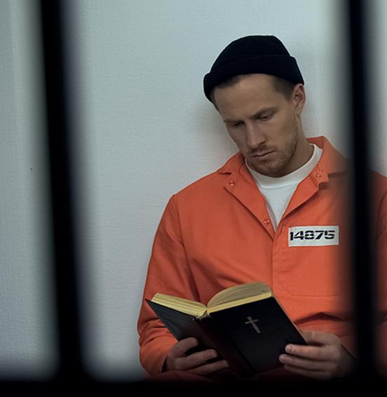 Inmate reading Bible